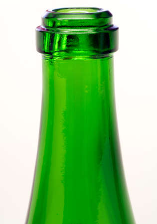 Green bottle neck close-up over white background
