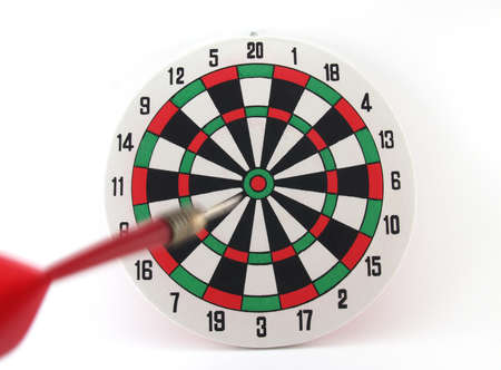 darts flying: Dart approaching the target on White background