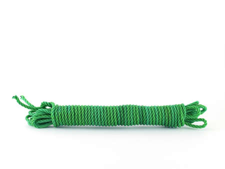 string together: green Nylon rope isolated on white background