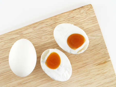 salted eggs on a wooden cutting board