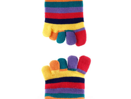 pinkie: colorful long socks on white background Stock Photo