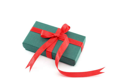 gift parcel: Gift box with red ribbon on white background
