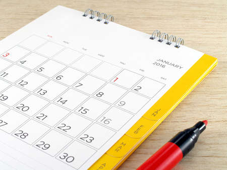 marker pen: calendar with red marker pen on wooden table background