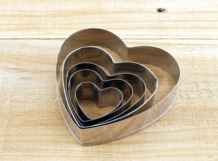 wood cutter: heart shaped cookie cutter on wood kitchen table