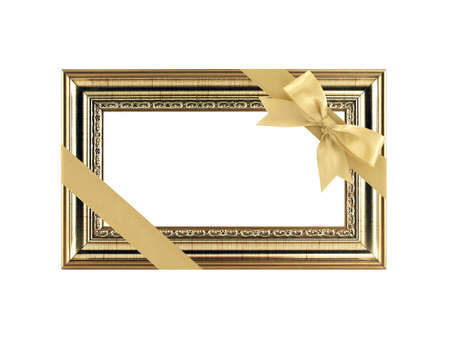 close up single antique golden picture frame with yellow gold diagonal ribbon bow and copy space isolated on white background, wooden carved vintage frame retro classic style for gift to home decor