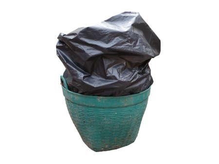 close up black garbage bag (trash bag) overflow old and grimy green plastic trash basket (garbage bin) isolated on white background Reklamní fotografie