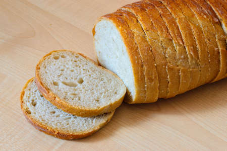 bakery products: Loaf of bread on the wooden table. Indoor.