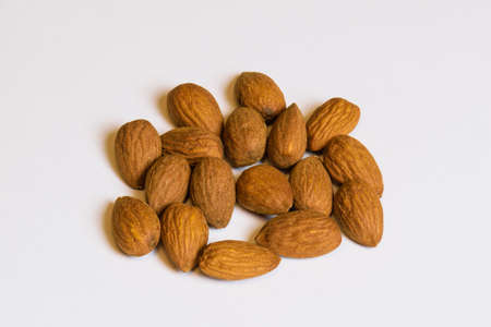 Almond nuts on white background. Indoor close-up. Stock Photo