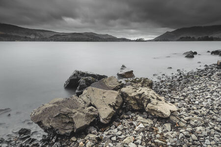 A view across Derwent Water in the Lake District, Cumbria. Dark clouds gather overhead. Stock Photo - 26044315