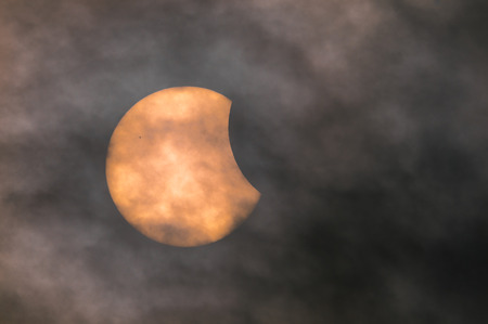 sunspot: The Sun moments before first contact with the Moon during the solar eclipse of March 20th 2015.  There is a sunspot in the top left quadrant of the suns disc.