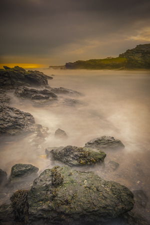 A long exposure of turbulent sea rushing into a small bay on Anglesey in North Wales.  The location is Porth Y Post.