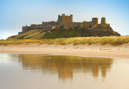 Bamburgh Castle and reflection in the sea.