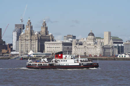 liverpool: Pier head buildings in Liverpool from across the River Mersey
