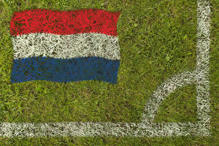 Flag of Holland painted on football pitch