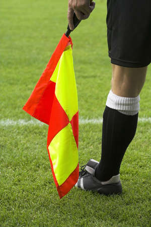 offside: A linesman at a footballl match