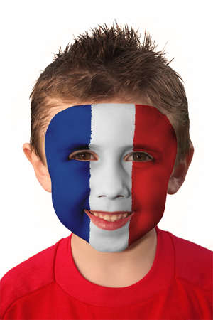 Young boy with France flag face paint