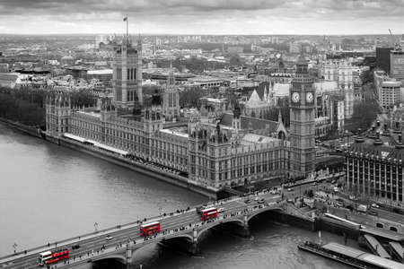 Black and White Aerial view of the Houses of Parliament with selective colour red london Buses