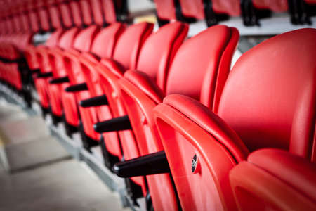 Seating inside a sports stadium Stock Photo