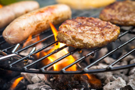 bbq grill: Meat cooking on a barbecue BBQ grill Stock Photo