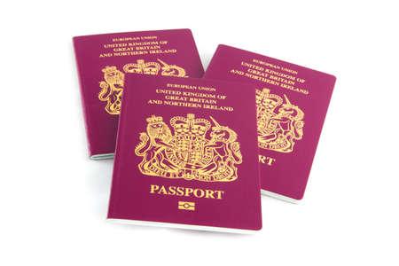 passport: Three British Passports Stock Photo