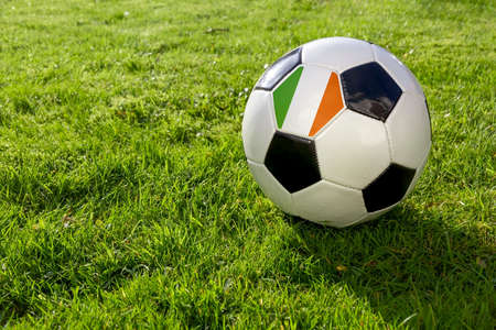 Football on a grass pitch with Republic of Ireland Flag