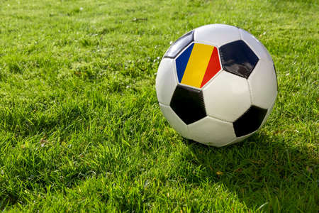 Football on a grass pitch with Romania Flag 版權商用圖片