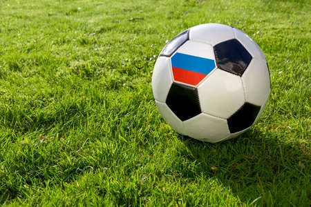 Football on a grass pitch with Russia Flag 版權商用圖片