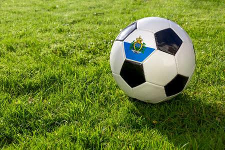 Football on a grass pitch with San Marino Flag 版權商用圖片