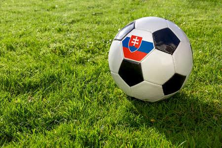Football on a grass pitch with Slovakia Flag
