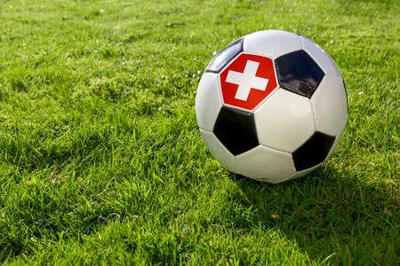 Football on a grass pitch with Switzerland Flag 版權商用圖片