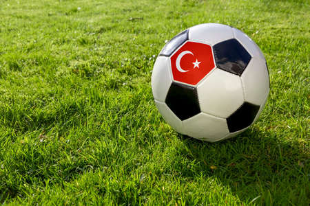 Football on a grass pitch with Turkey Flag