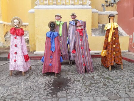 Antigua traditional dress of Guatemala on dummies, manikins, statues outside in the square for Independence day. Central America dress and clothes. Stock Photo