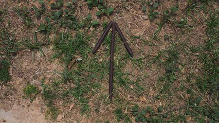 bush craft bushcraft stick arrow pointing up on grass and brown wooden sticks survival military sign signal