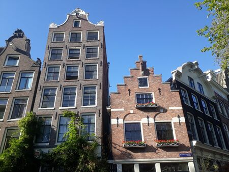 amsterdam architecture tall houses with gable ends tall apartments and offices in historic holland capital city
