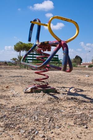 joyless: abandoned playground in sparse landscape