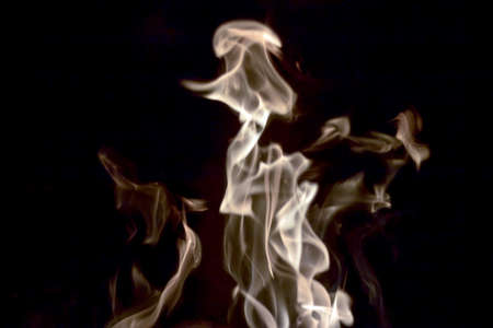 smolder: muted flames from log fire Stock Photo