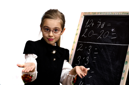 schoolgirl wrote on the blackboard isolated on a white background