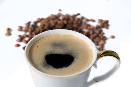 coffe bean: cup of coffe with coffe bean isolated Stock Photo