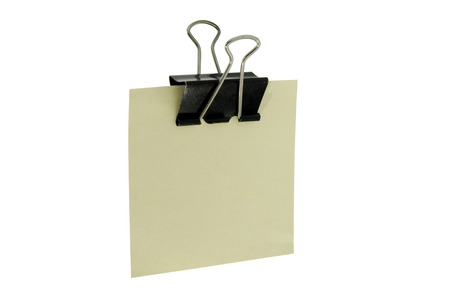 clerical: clerical clothespin with piece of paper on white background