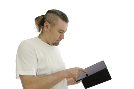 heir: man with heir using laptop on white background