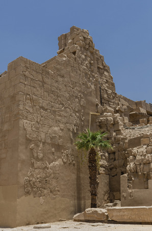 Ruins of the Karnak Temple in Luxor, Egypt. Ruined wall. Ancient architecture in Luxor, Egypt