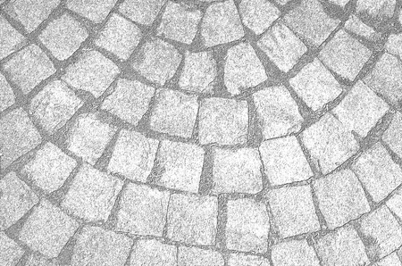 Pattern on the paved road, background, texture. a stone road in the city. stone road surface. sidewalk. black and white background