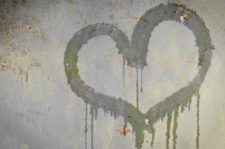 painted heart on a rusty iron background. metallic rust texture with heart shape 版權商用圖片
