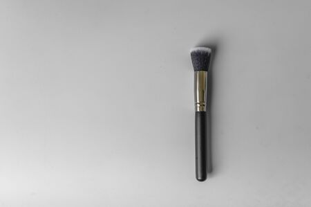Professional makeup brush on grey background