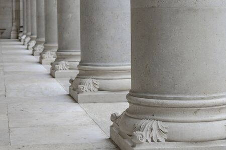 Architectural details of the building. Row of white columns.