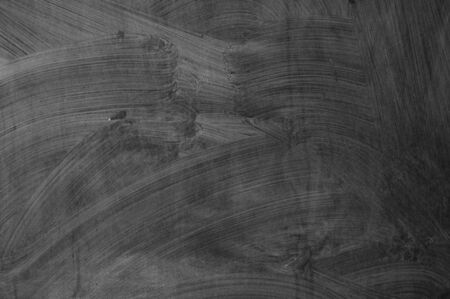 blackboard texture wall and black background, copy space. close up of a black dirty chalkboard Stock Photo