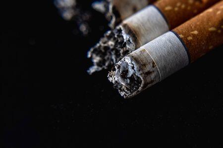 Cigarette butt on a black background Stockfoto