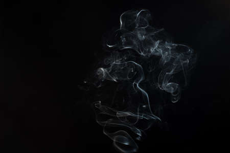Beautiful smoke abstract on black background. Background from the smoke of vape
