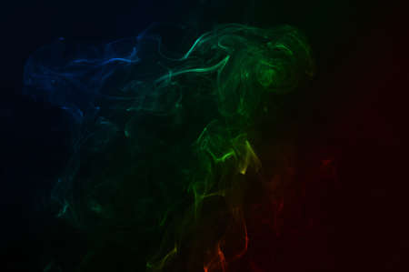 Beautiful colorful smoke abstract on black background. Background from the smoke of vape 免版税图像