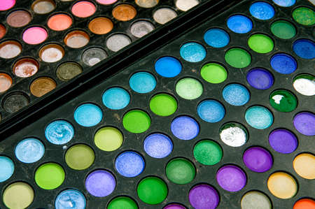Old palette with multi-colored cosmetic shadows. A set of multi-colored eyeshadow.